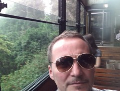 Frank Dux riding on the Peak Tram